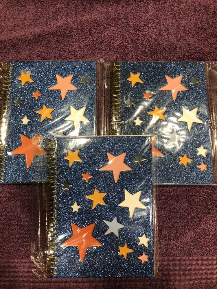Notebooks with blue sparkle and star cov