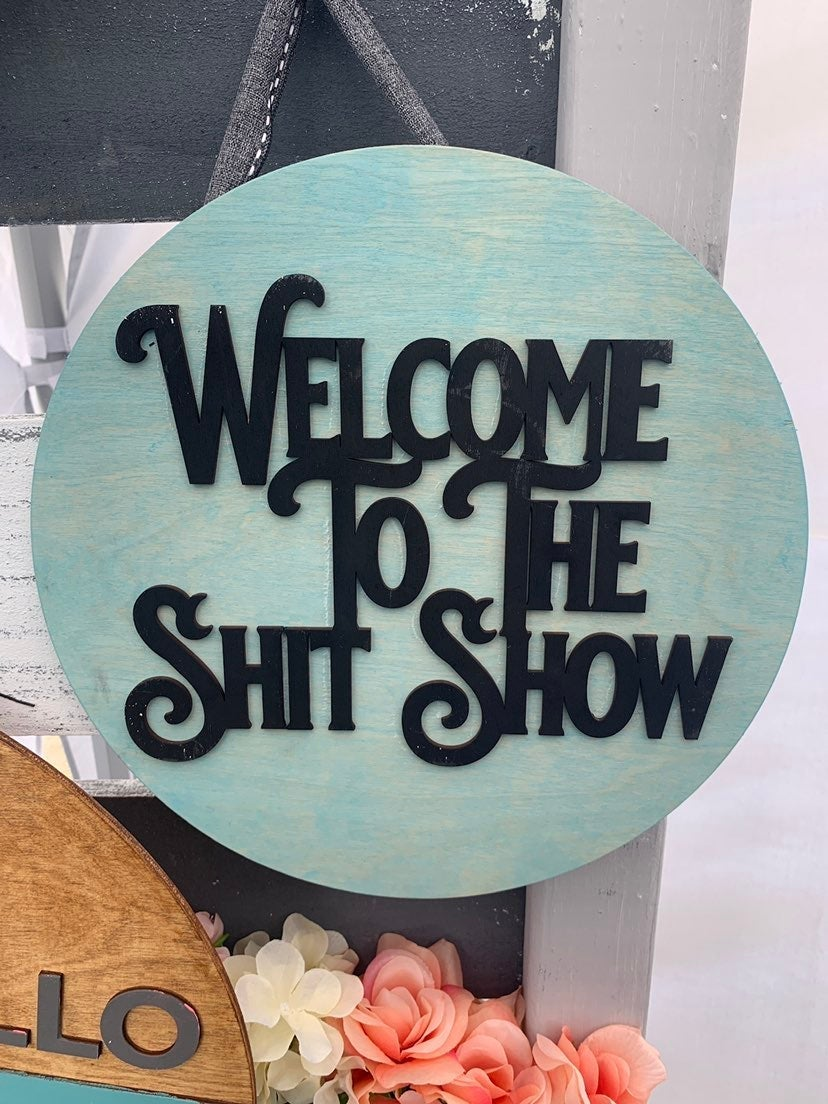 Welcome to the shitshow sign