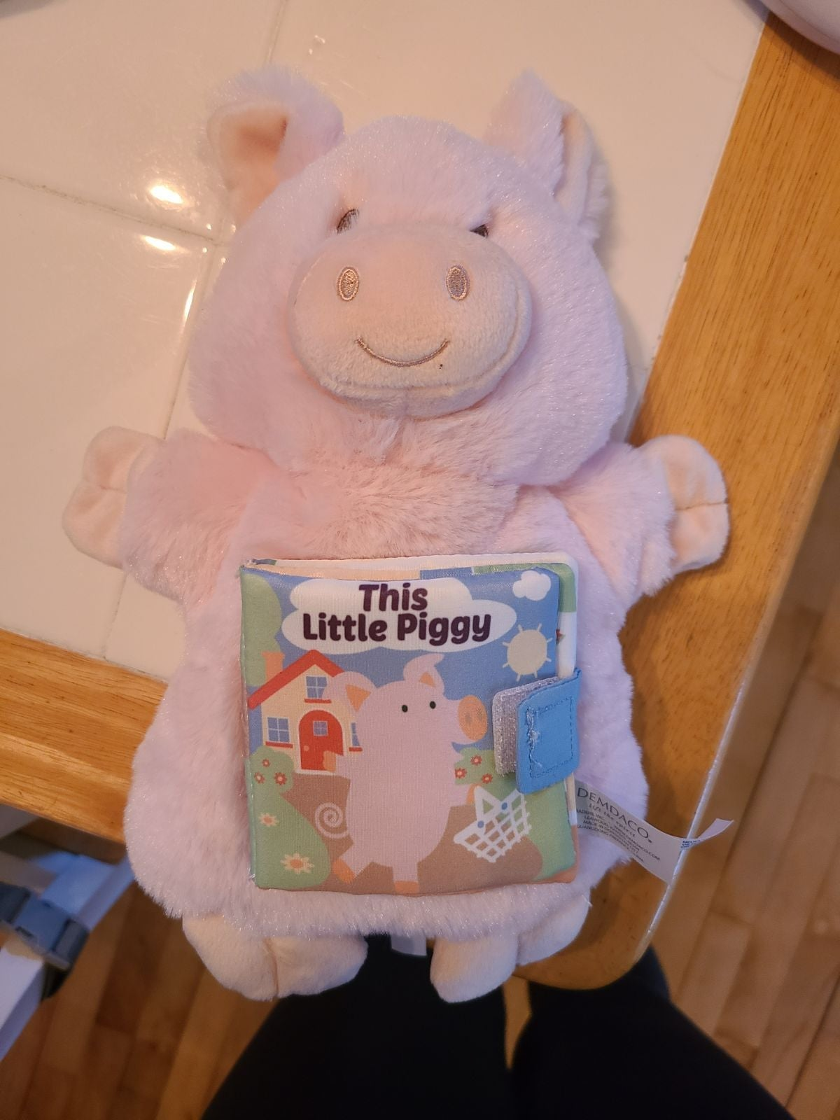 Piggy puppet with book attached