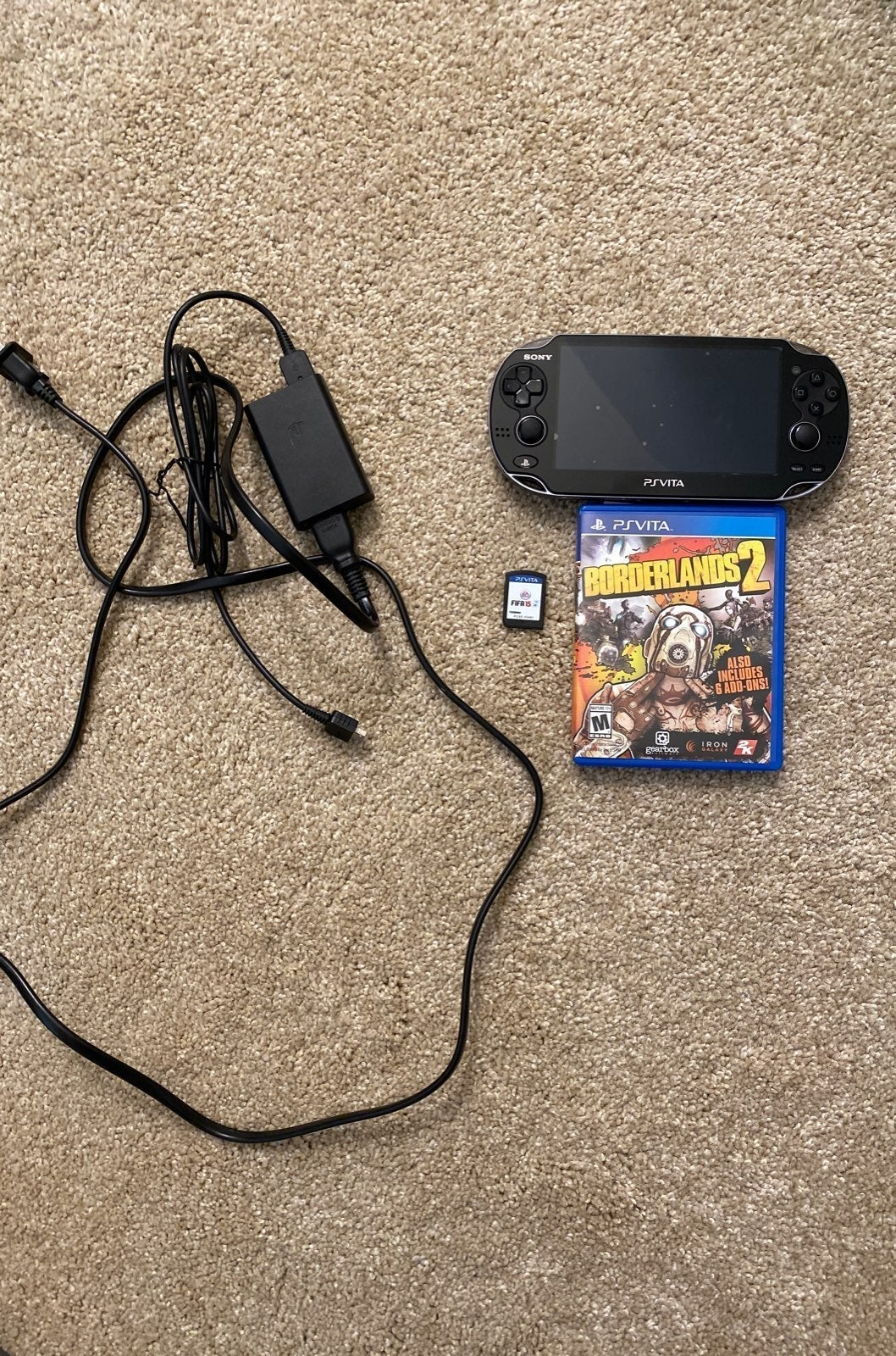 PS Vita Black w/ Charger & Games