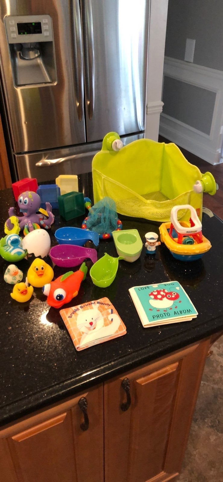 lot of bath toys and storage