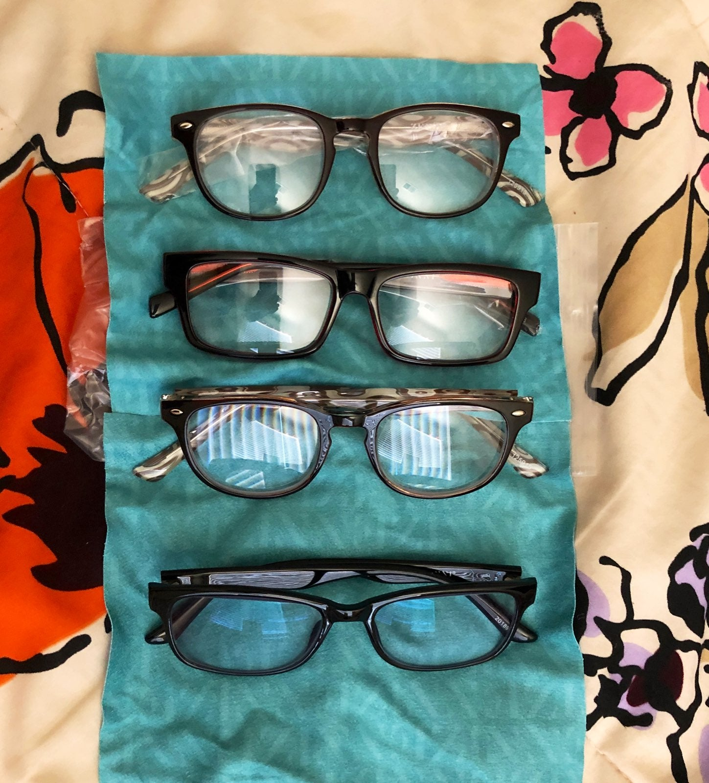 FOUR BRAND NEW PAIRS OF READING GLASSES