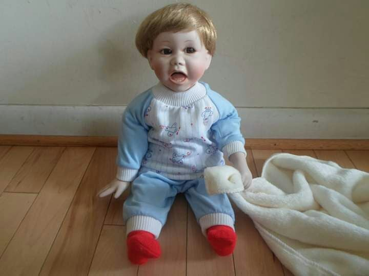 "porcelain doll 21"" tall"