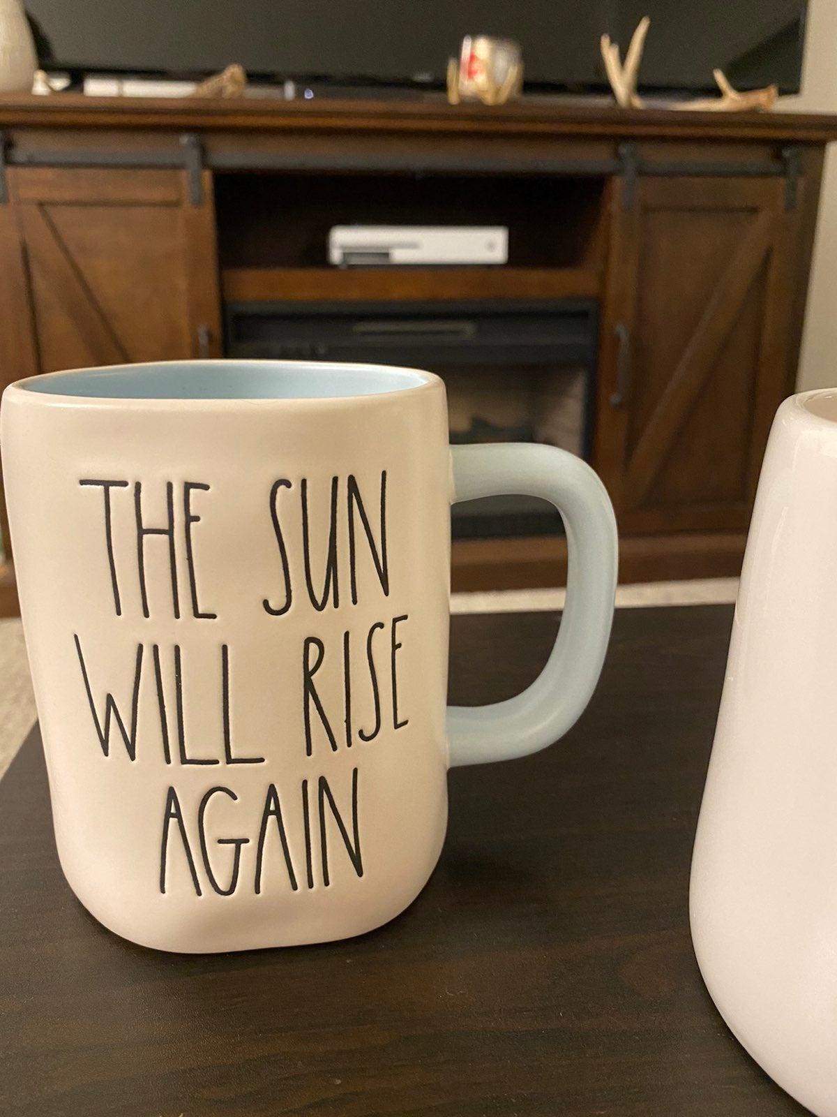Rae Dunn the sun will rise again mug