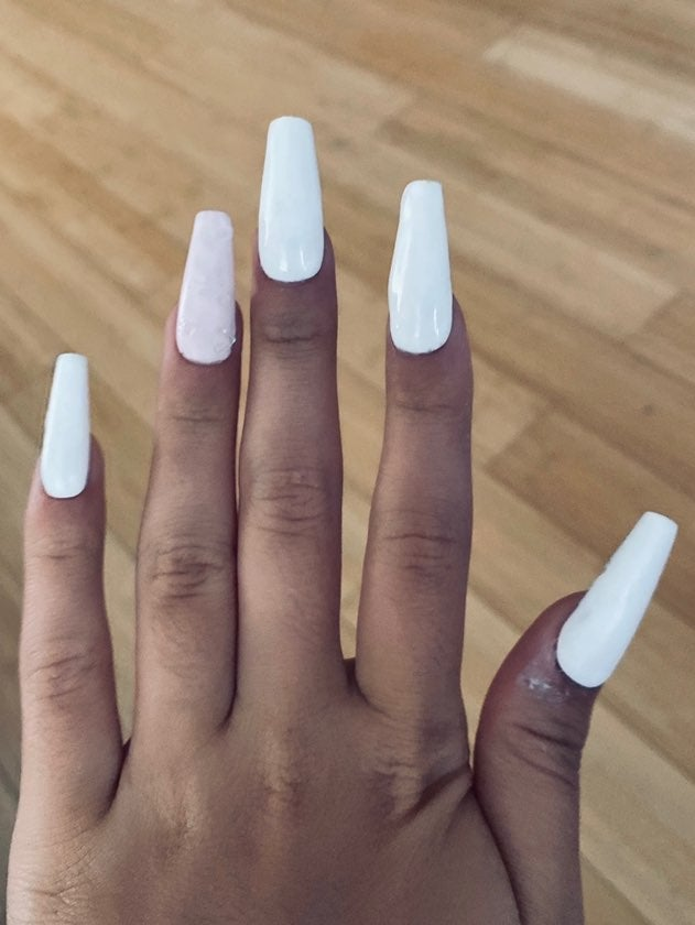 White nails with hearts on ring finger