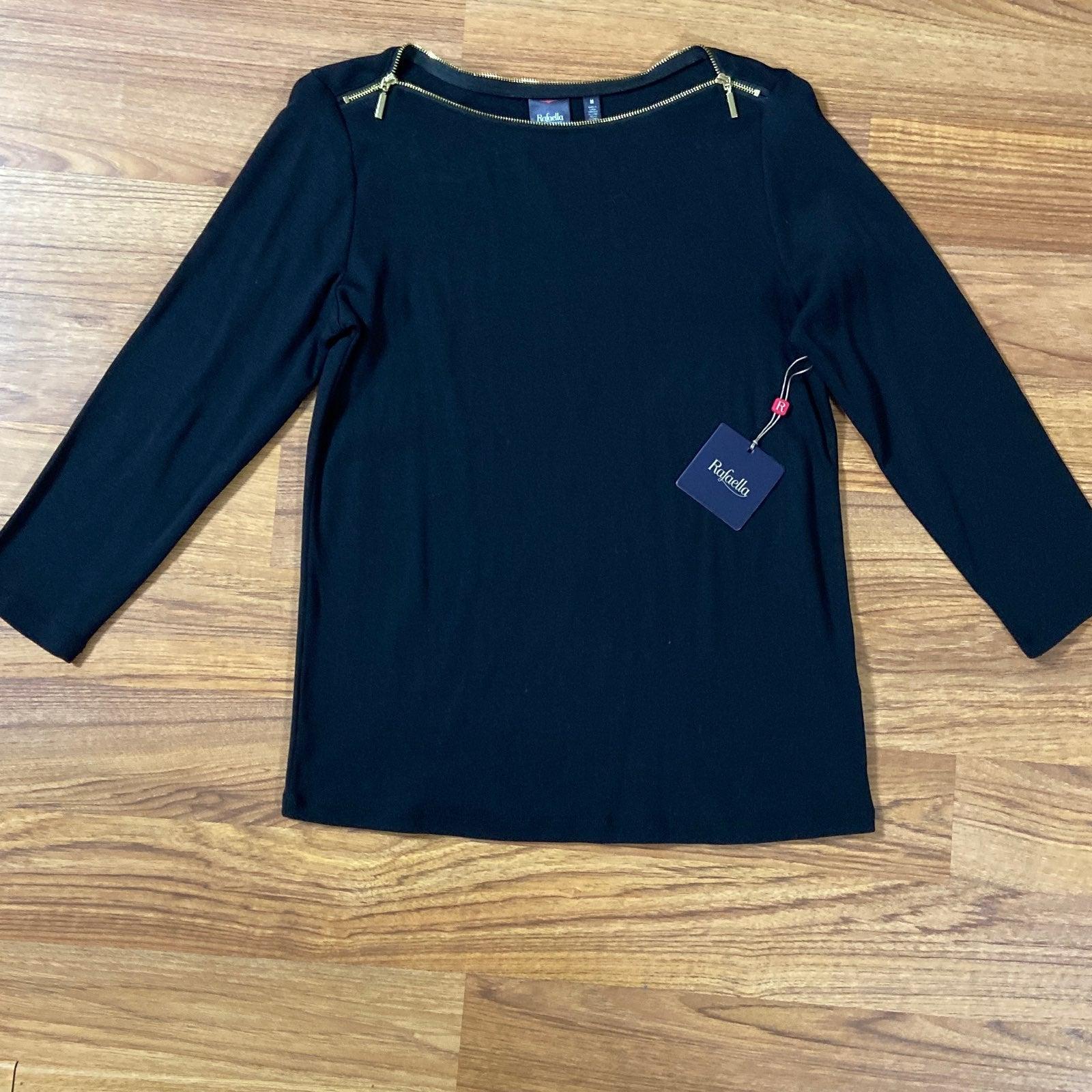 Women's black top with gold zipper