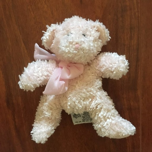 pink teddy bear named Bubbles with bow