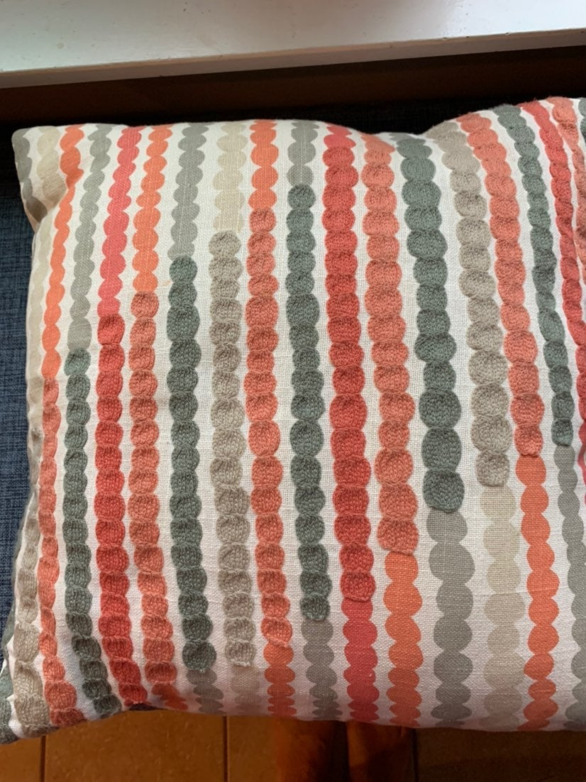Coral and grey throw pillow