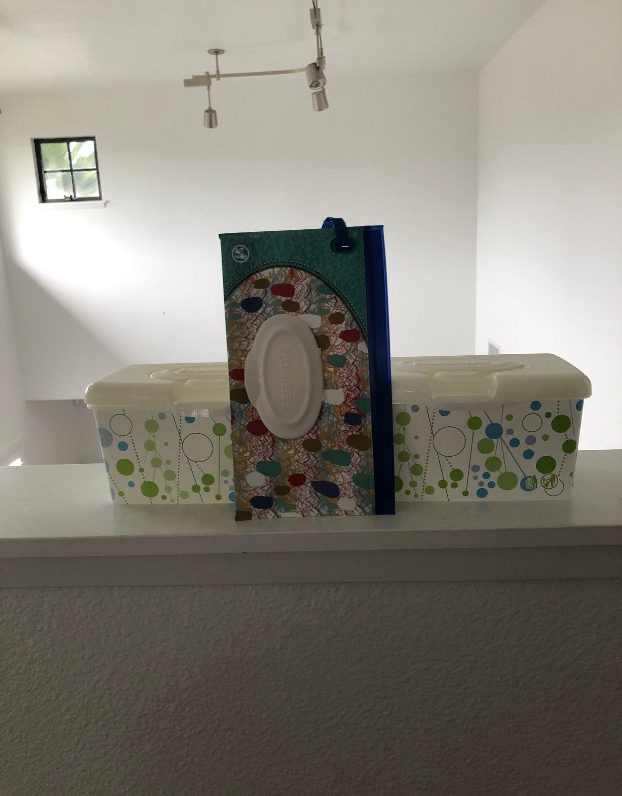 Empty Huggies clutch/containers