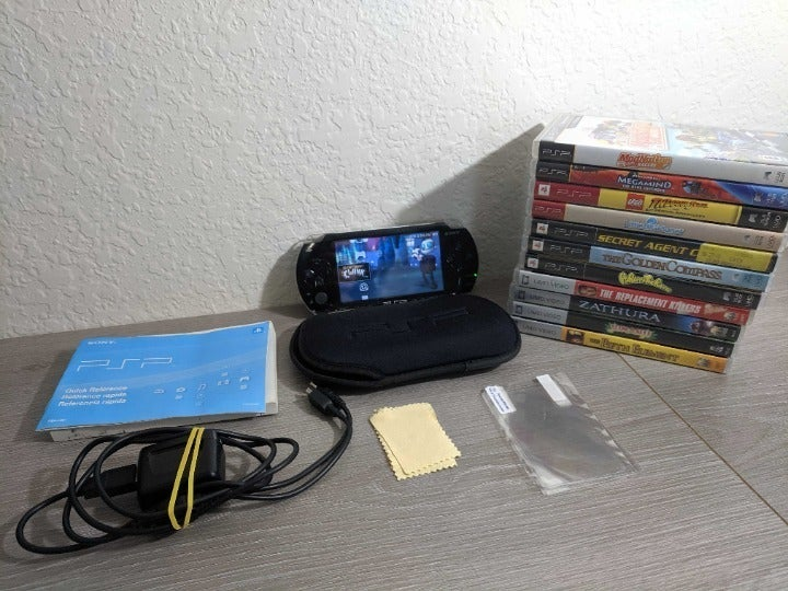 Sony PSP 1001 with 7 Games and 4 Movies!
