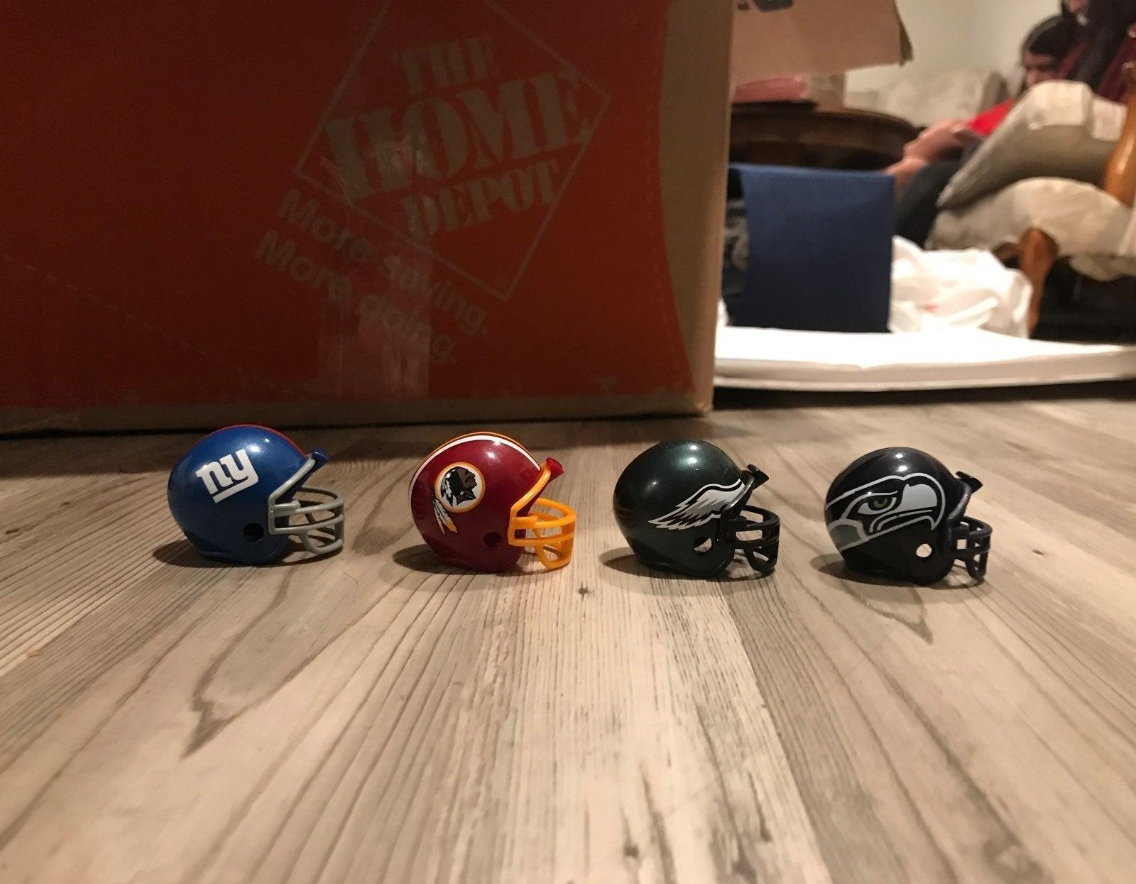 LOT of 4 riddell's miniature NFL helmets