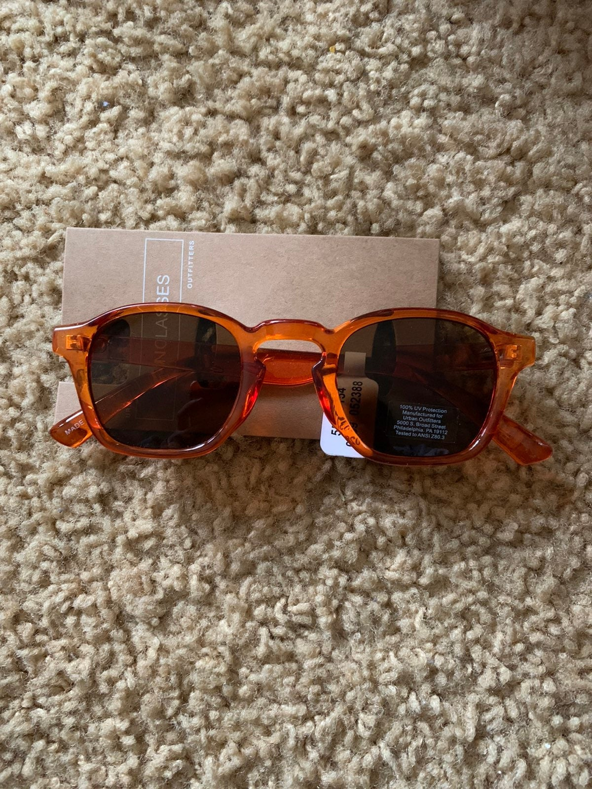 Urban Outfitters orange sunglasses