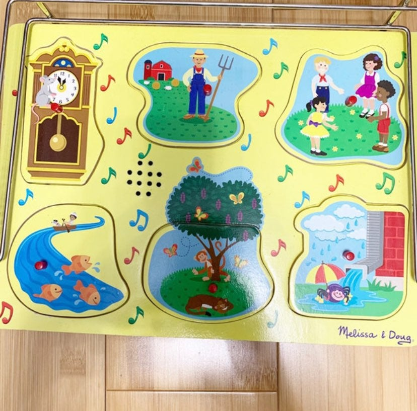 Melissa + Doug musical puzzle.  Sing-alo