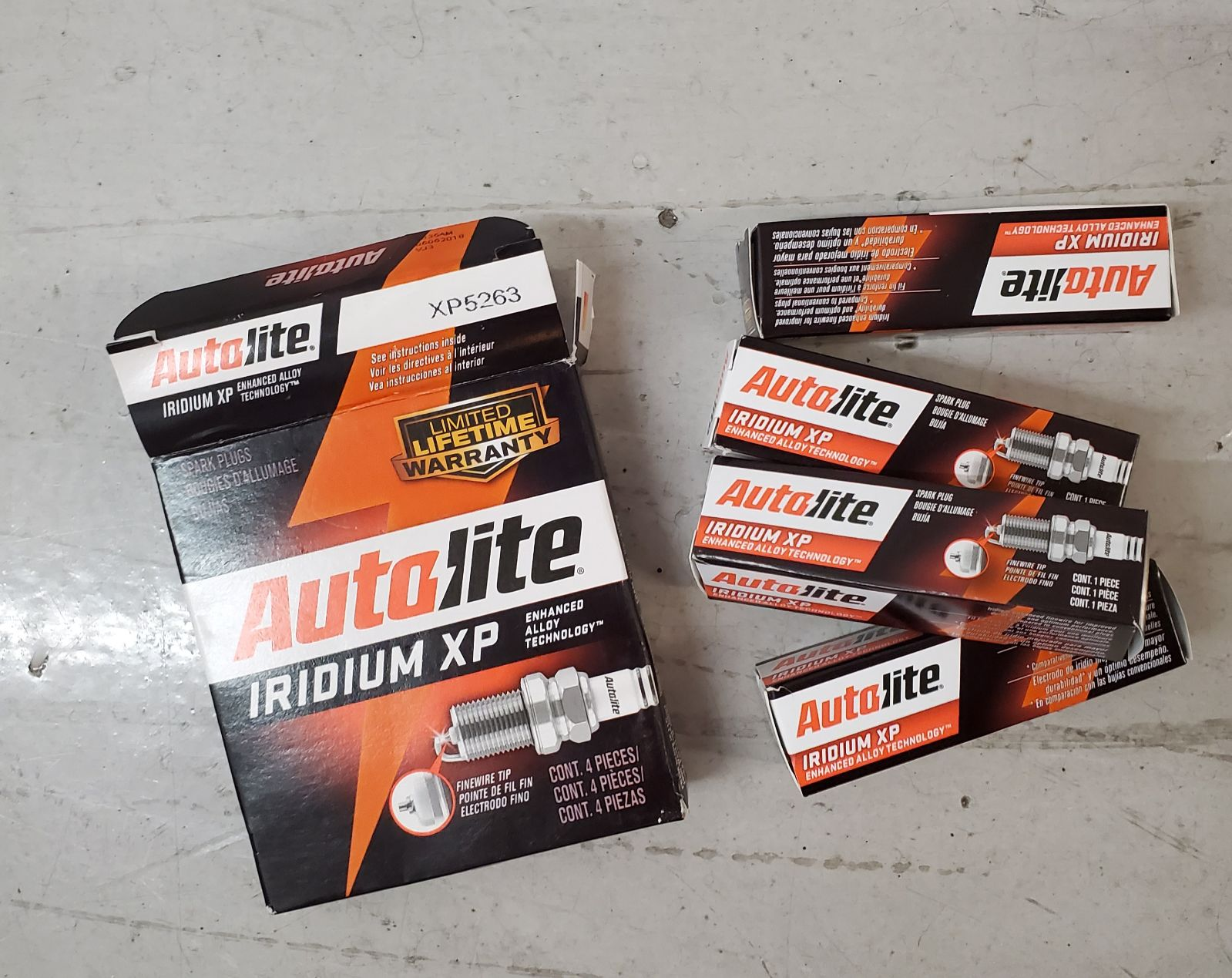 New 4pc Autolite Iridium XP Spark Plug