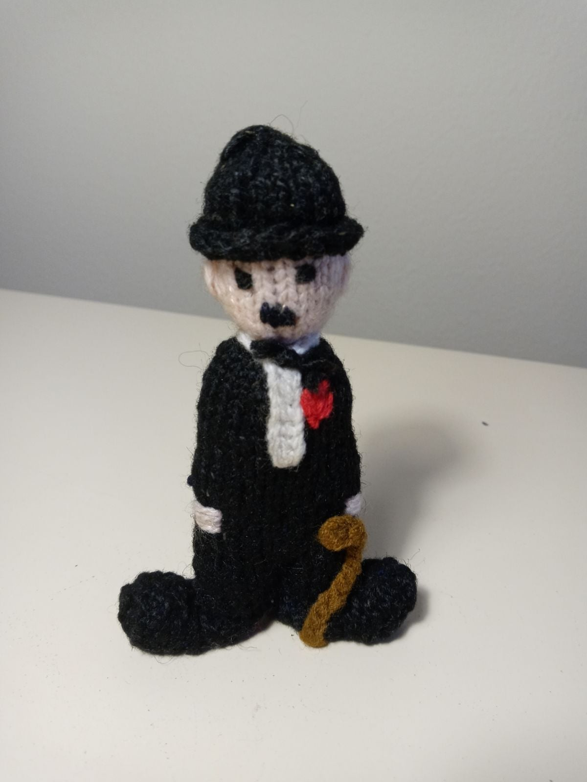 Small knitted Charlie Chaplin doll