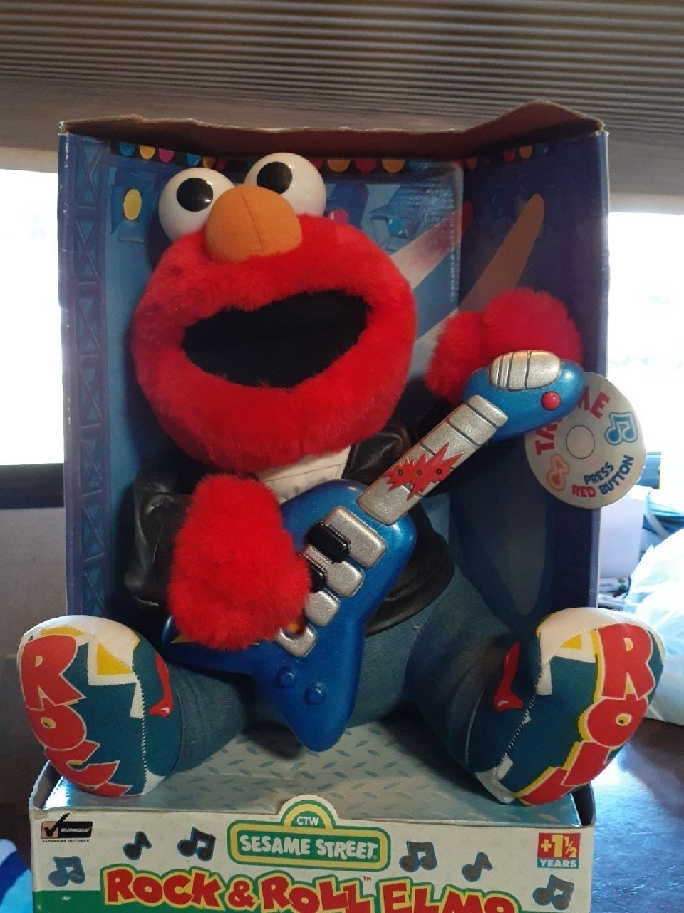 Rock and roll Elmo in original box