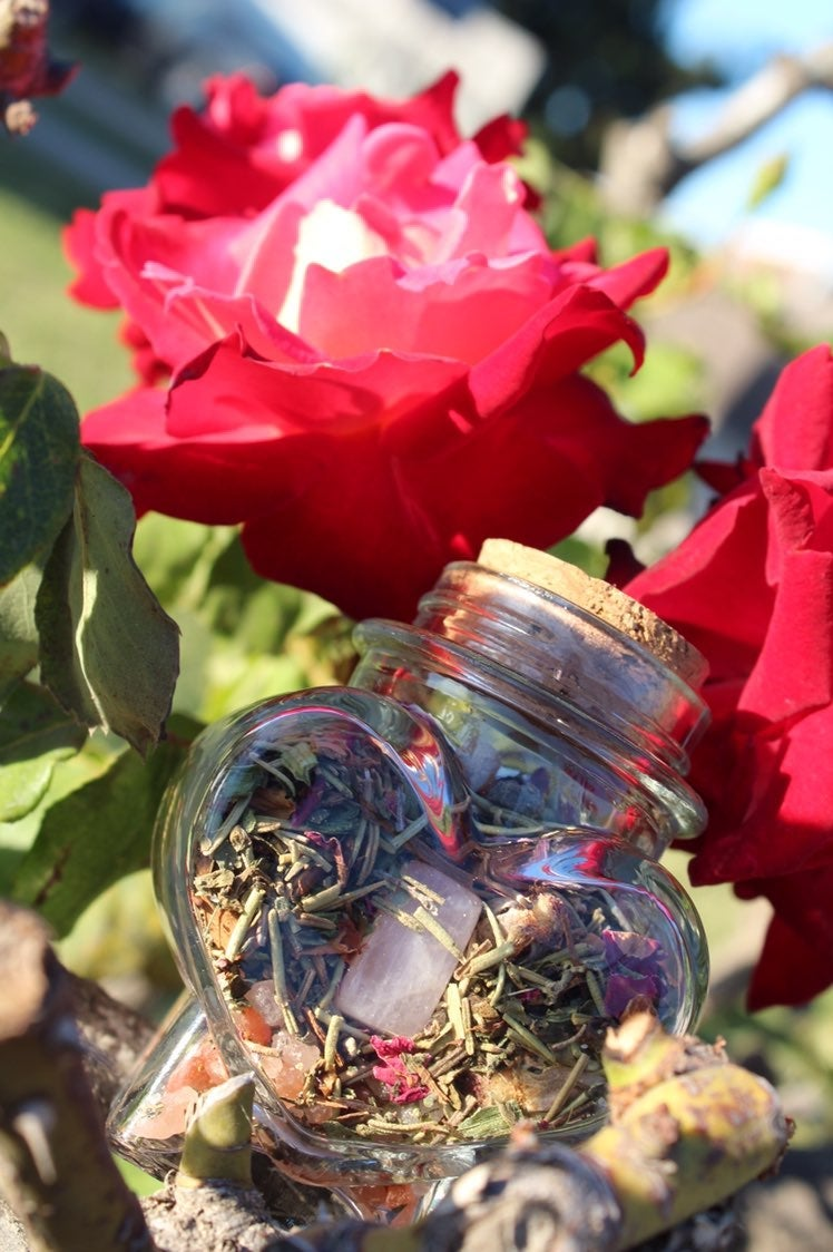 Herbal love spell jar with Rose Quartz
