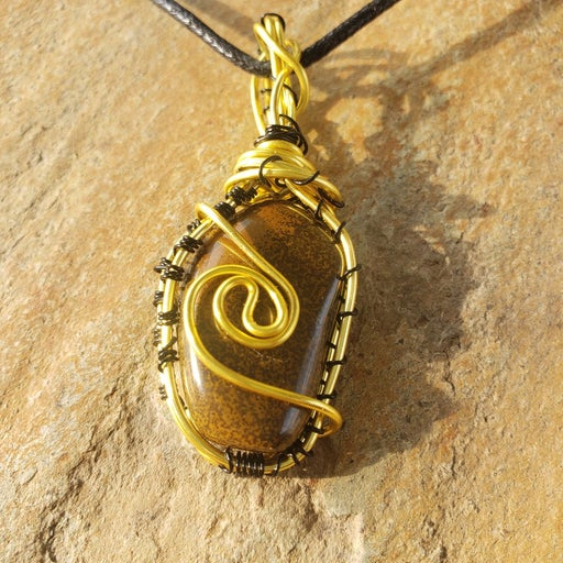 Tigers eye wire wrapped pendent