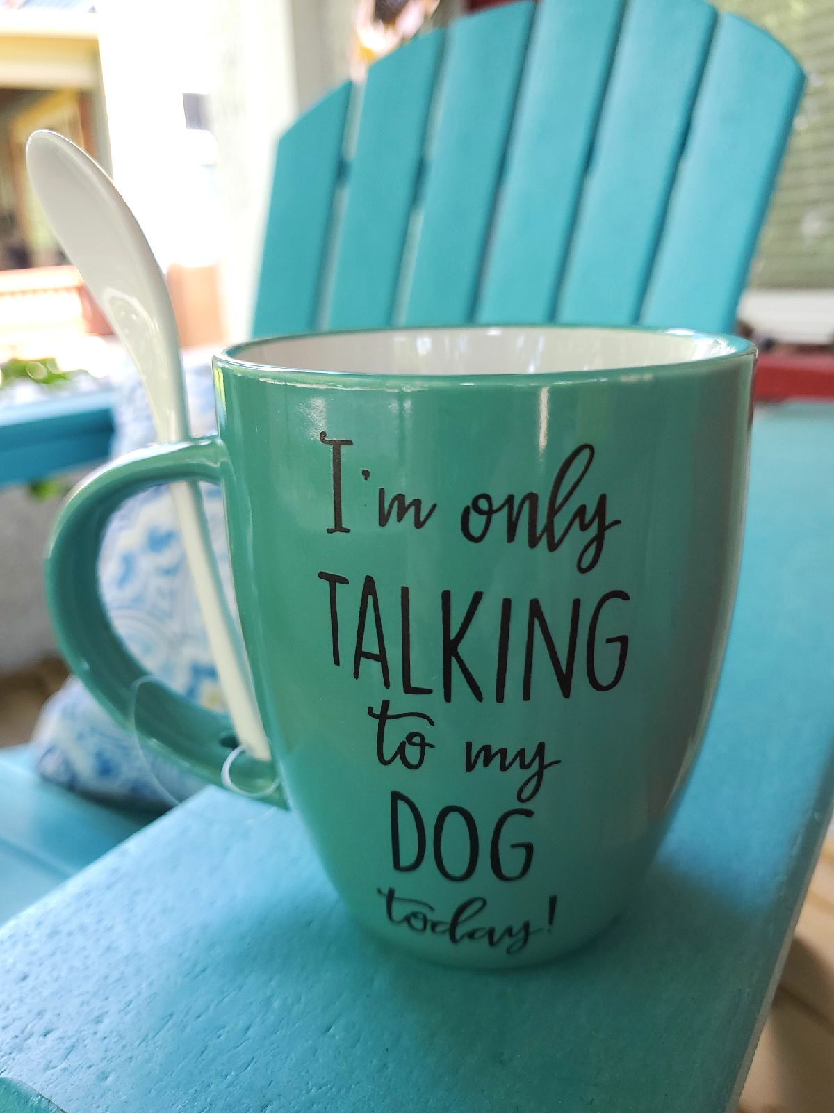 Whimsical turquoise mug with spoon