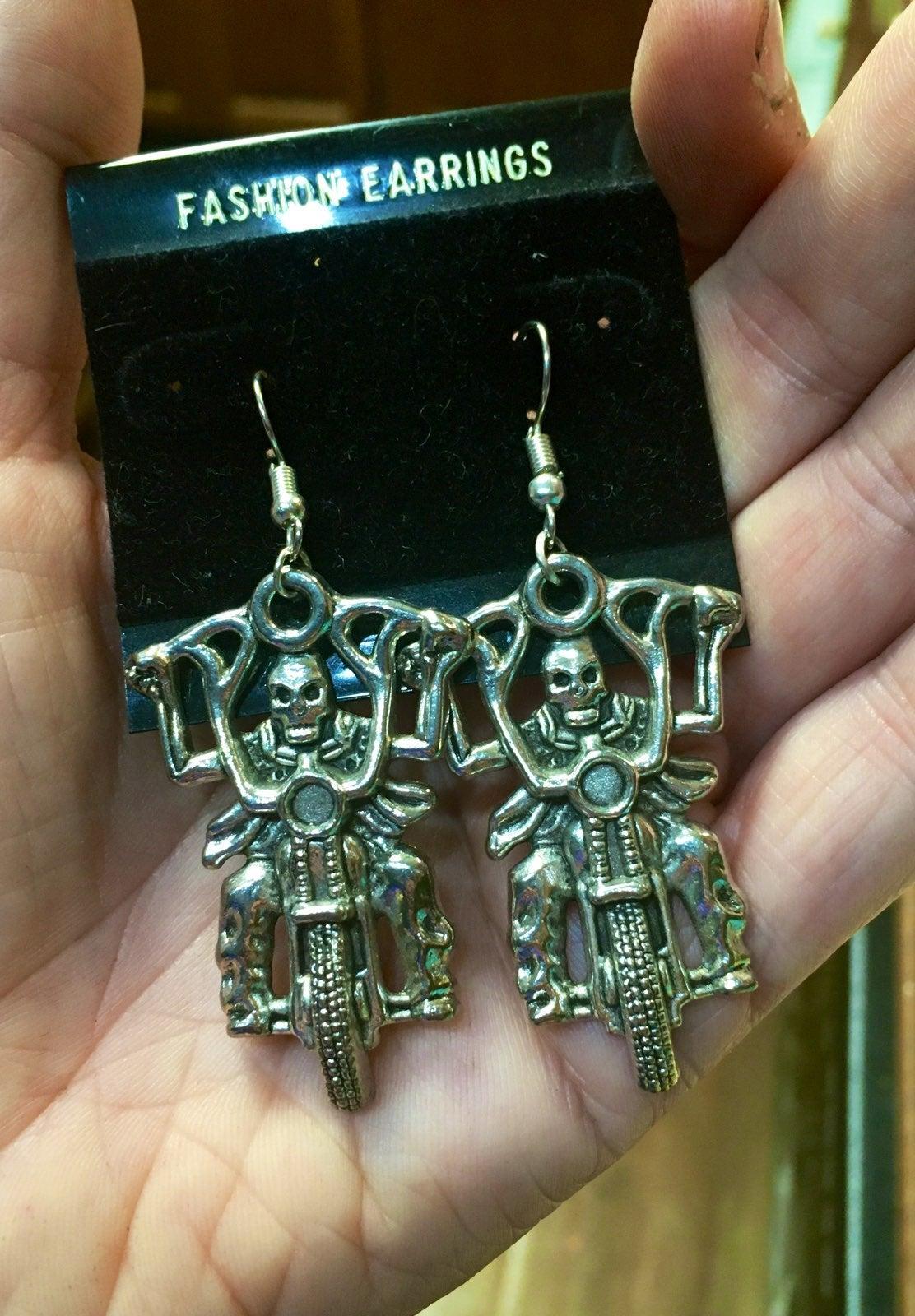Huge skeleton on motorcycle earrings