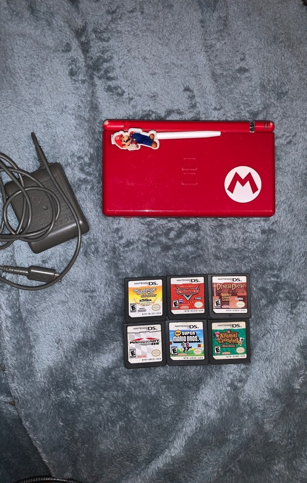 Nintendo Ds w/ games and a charger