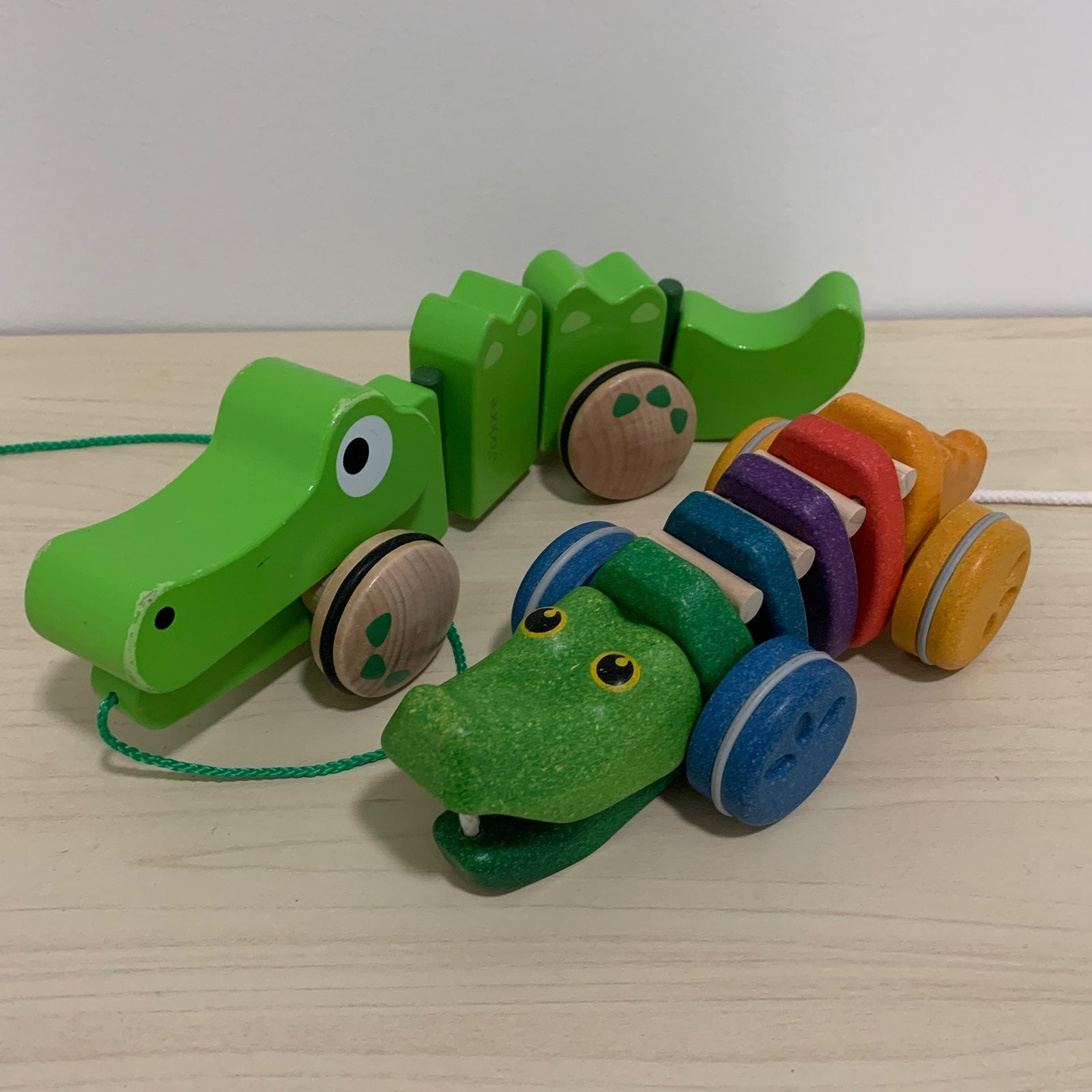 Two alligator pull toys
