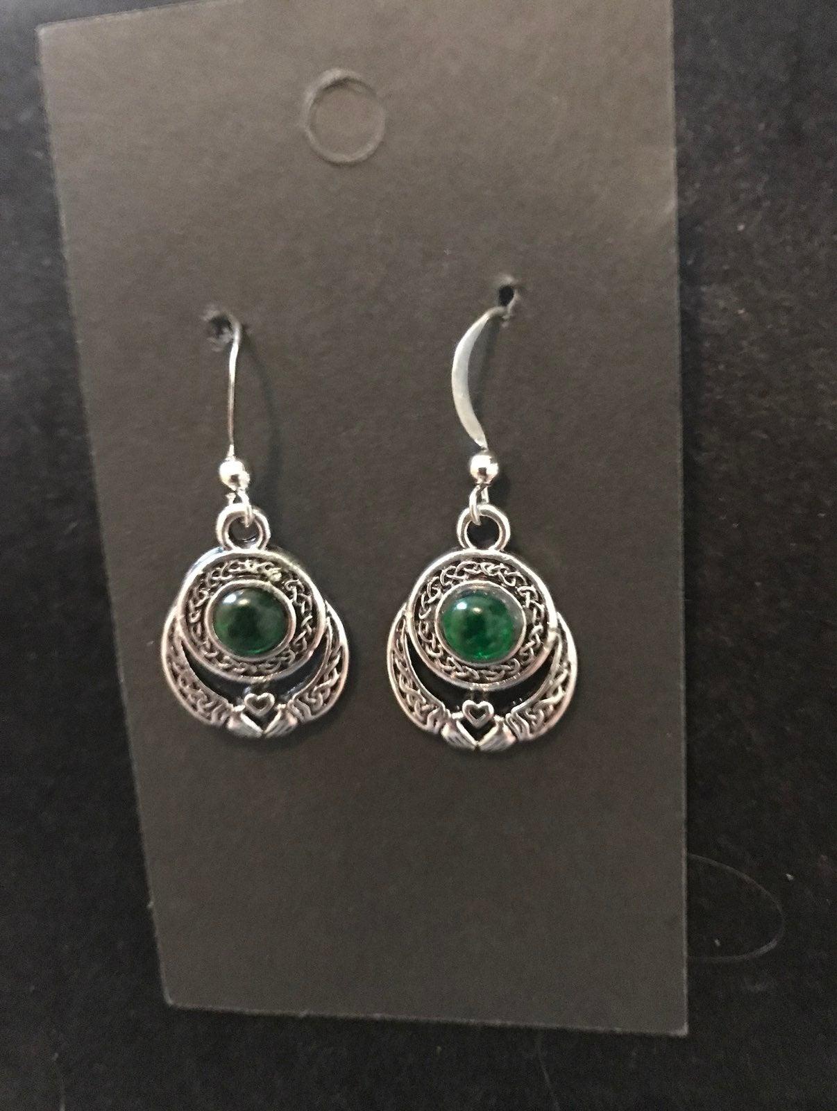 Sterling silver emerald earrings pierced