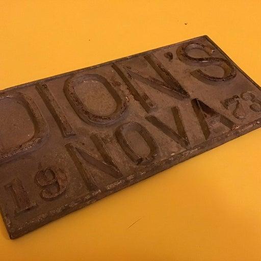 Vintage Metal License Plate Dion's Nova