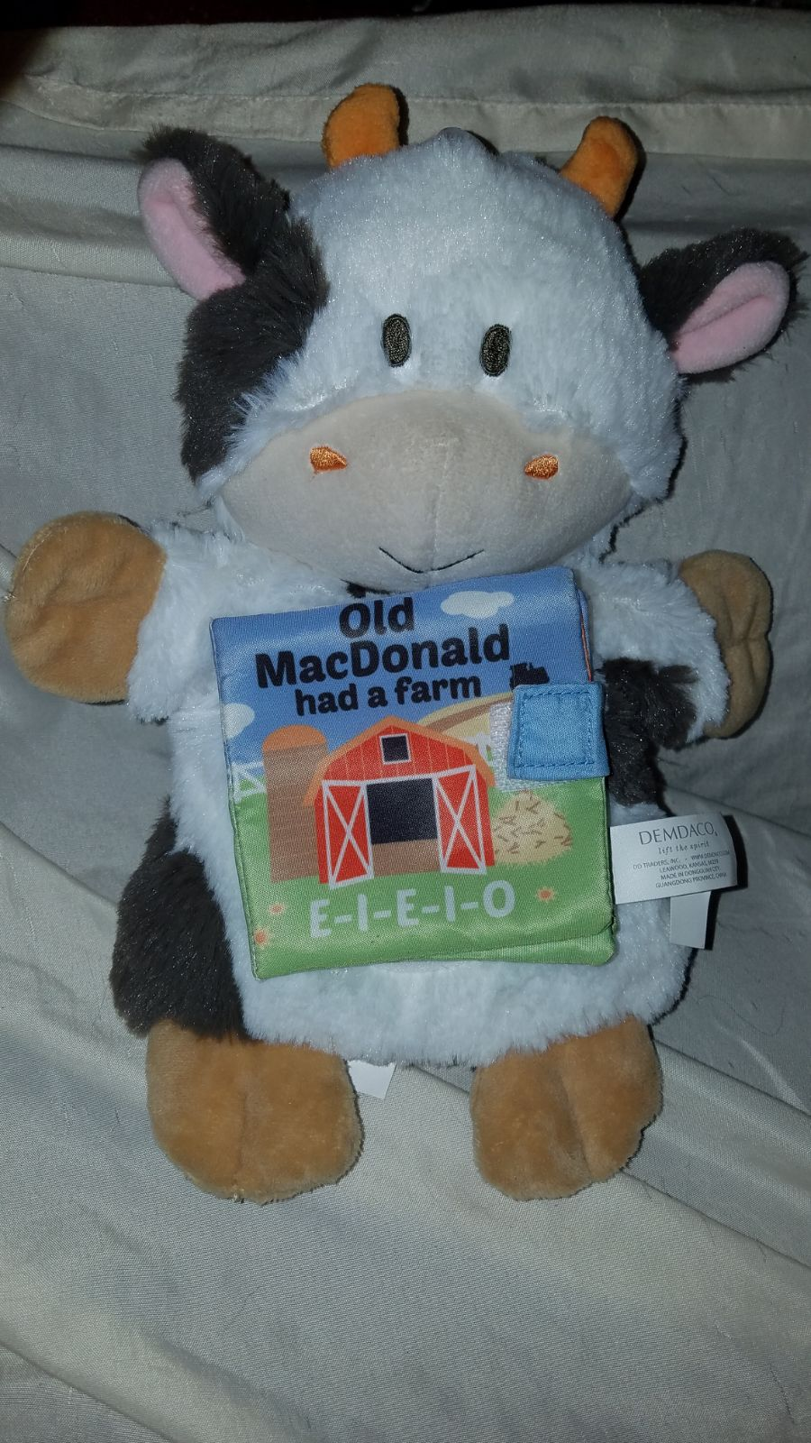 Plush cow puppet with soft book