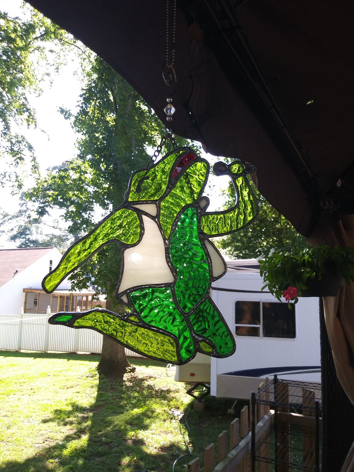 Singing frog stained glass