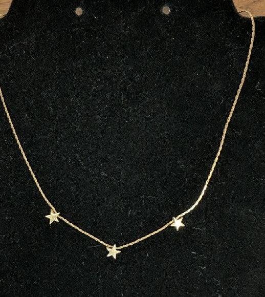 Avon Gold tone star necklace