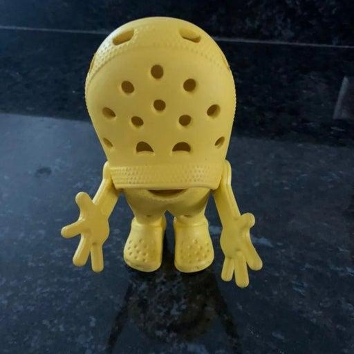 Yellow crocs croslite guy