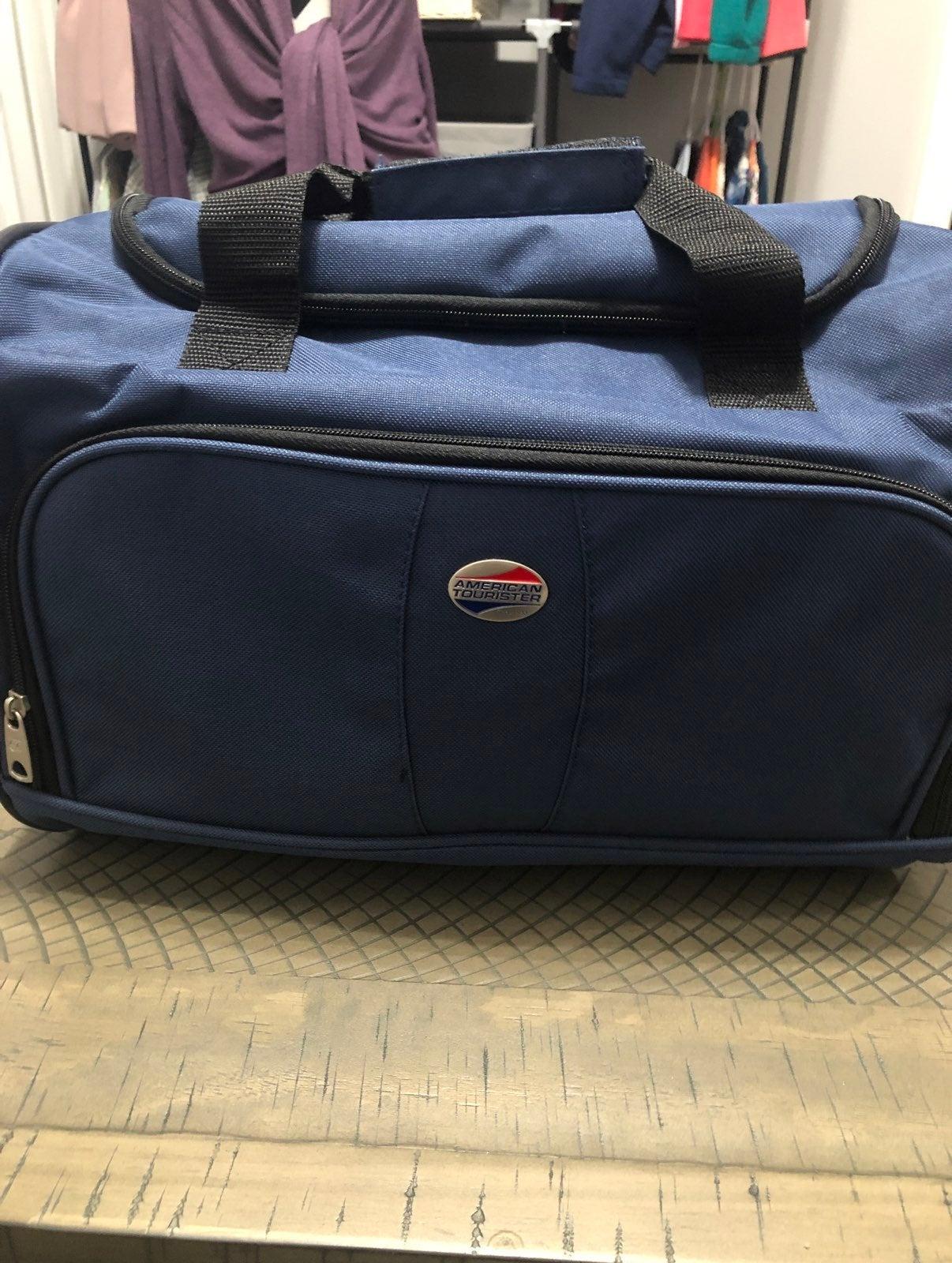 American Tourister Bag blue carry on bag