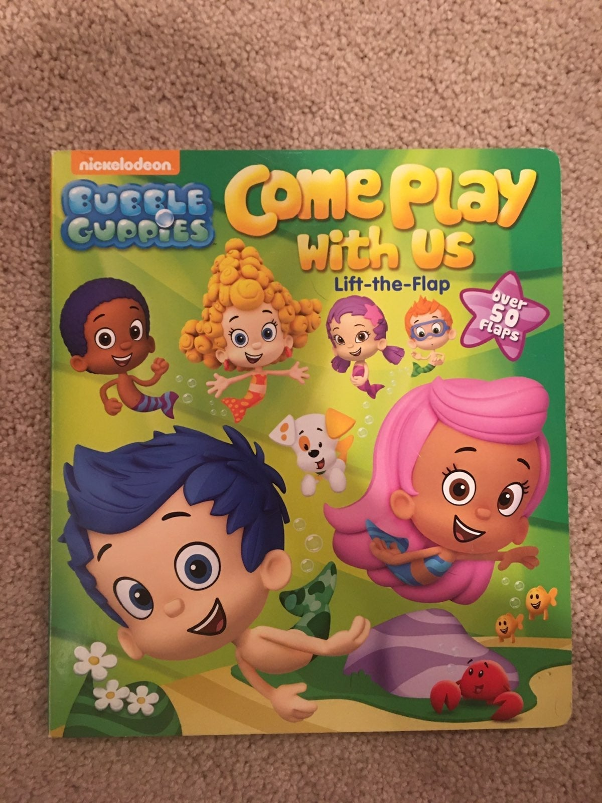 Bubble Guppies hard cover flap book