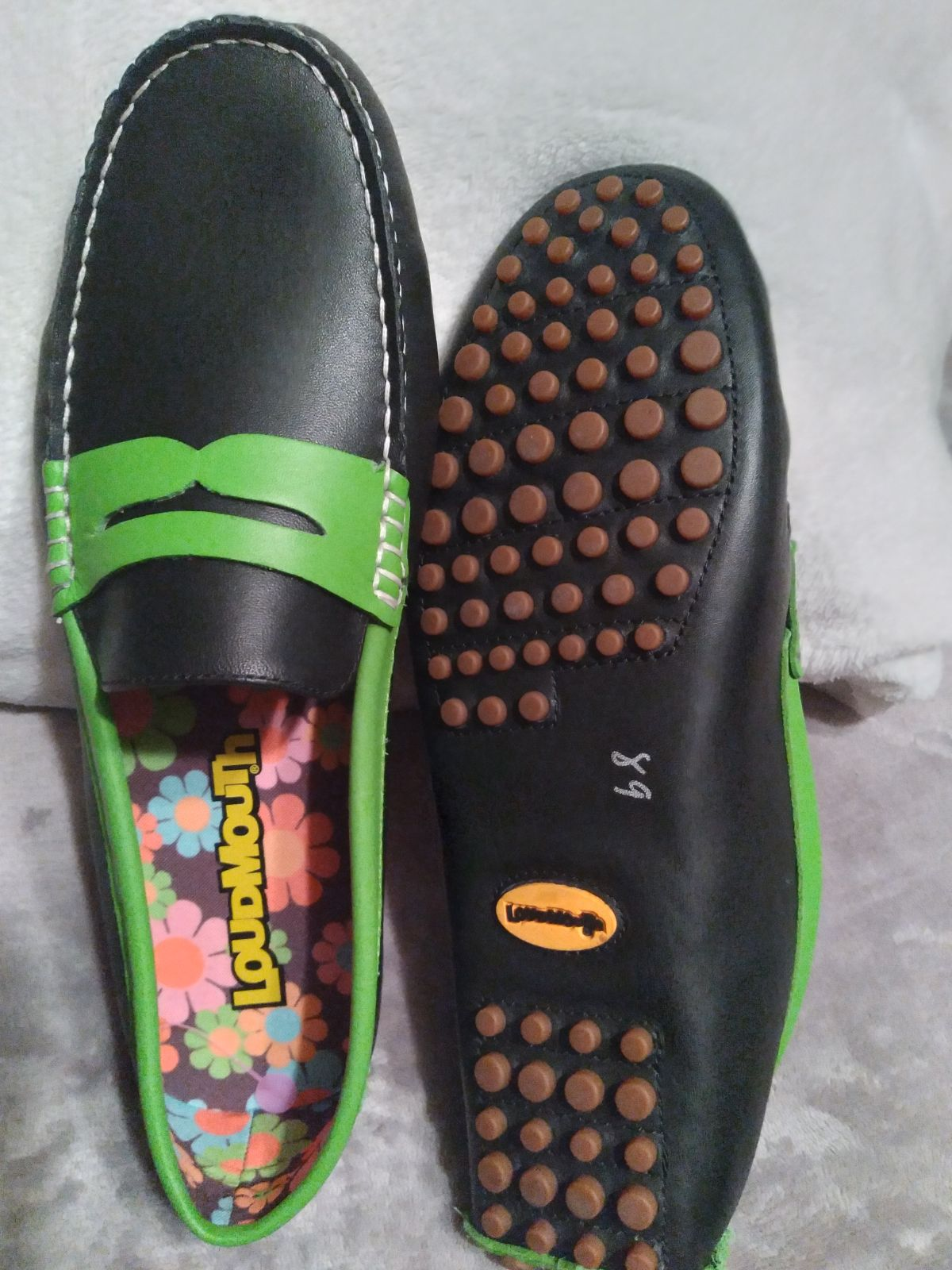Black and lime green Penny loafers.