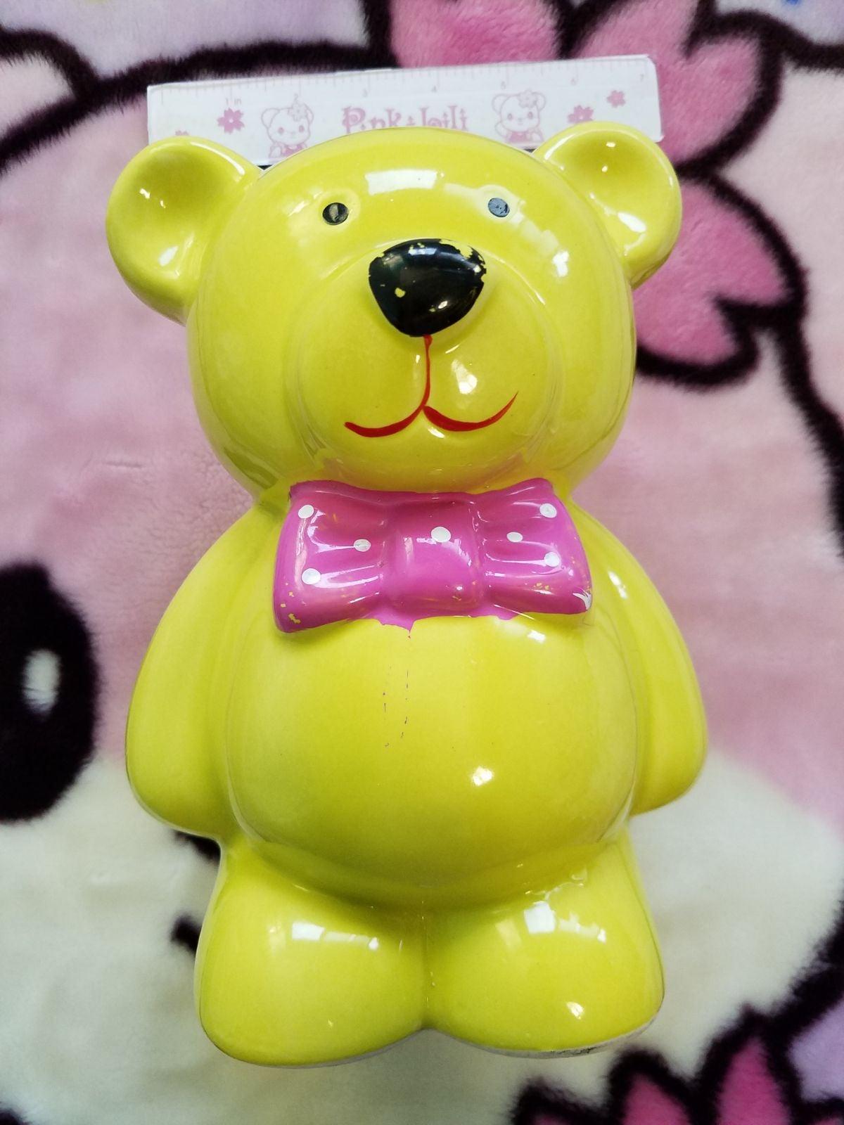 Teddy bear bank statue