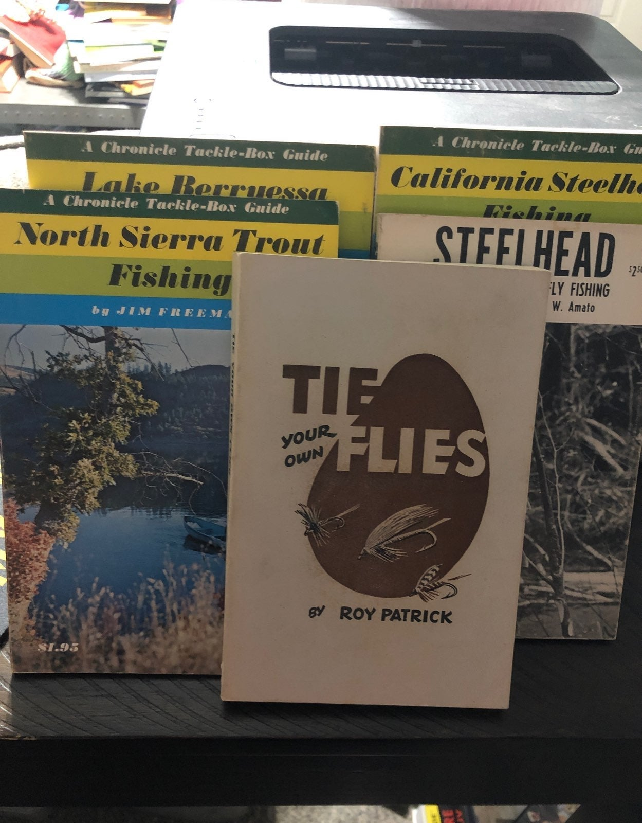 Four old fishing guides and a book on fl