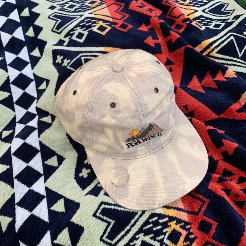 PGAWest custom reverse dye strapback hat