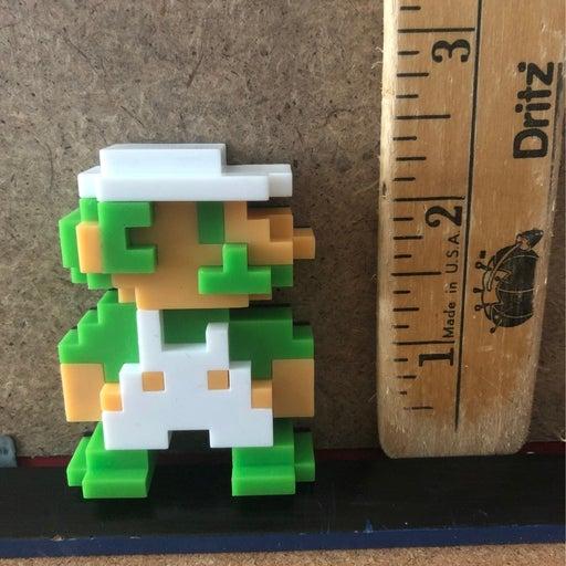Luigi 8bit figure by Nintendo and jakks
