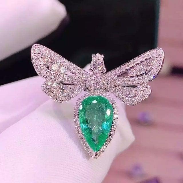 Platinum emerald HALO PEAR CUT ring