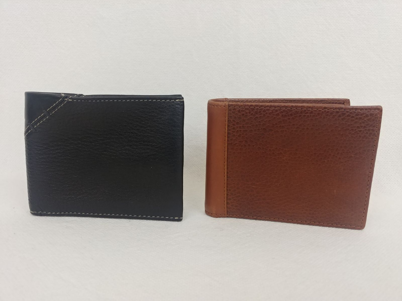 2 cole haan leather bifold wallets