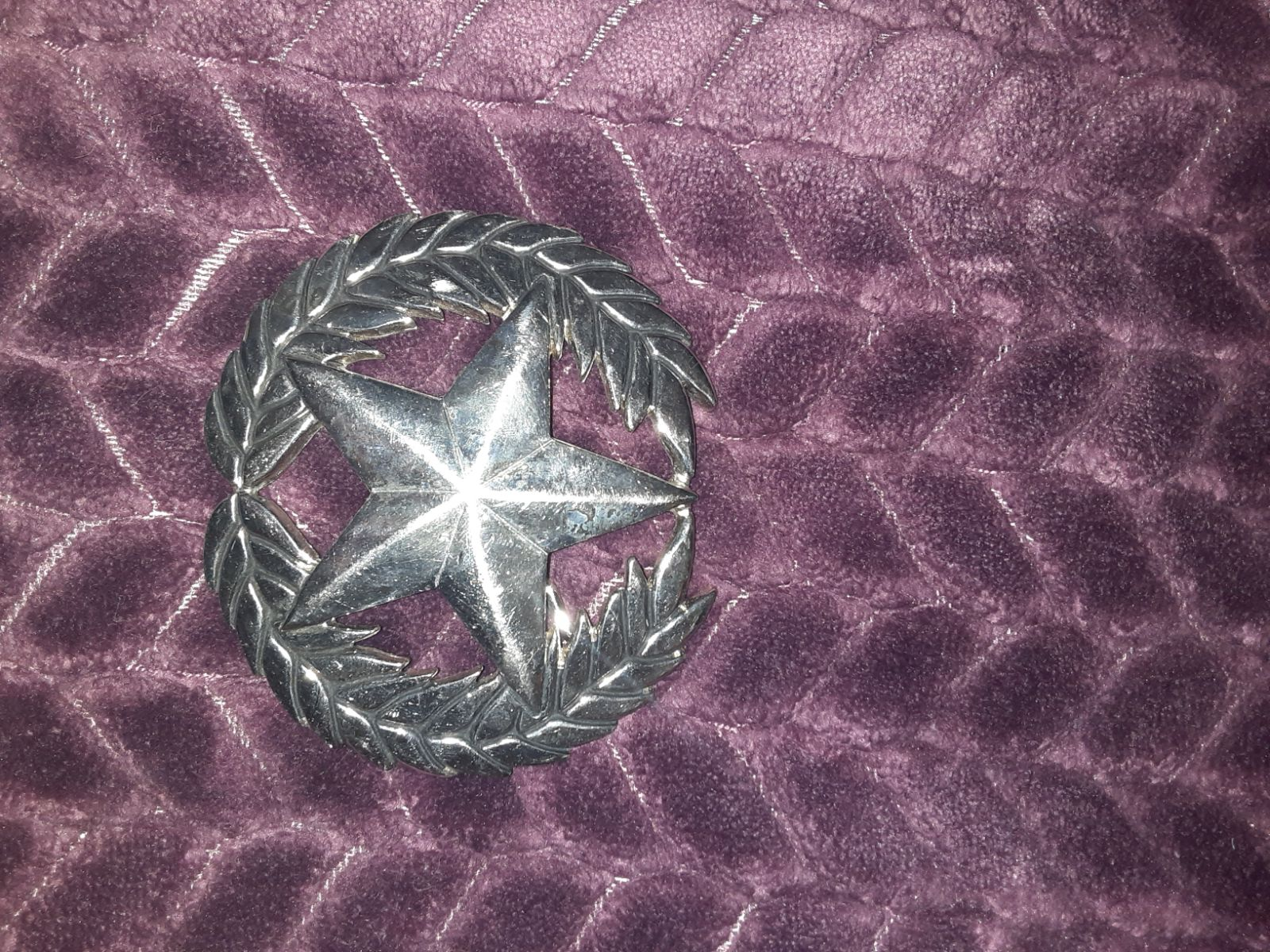 Silver star belt buckles
