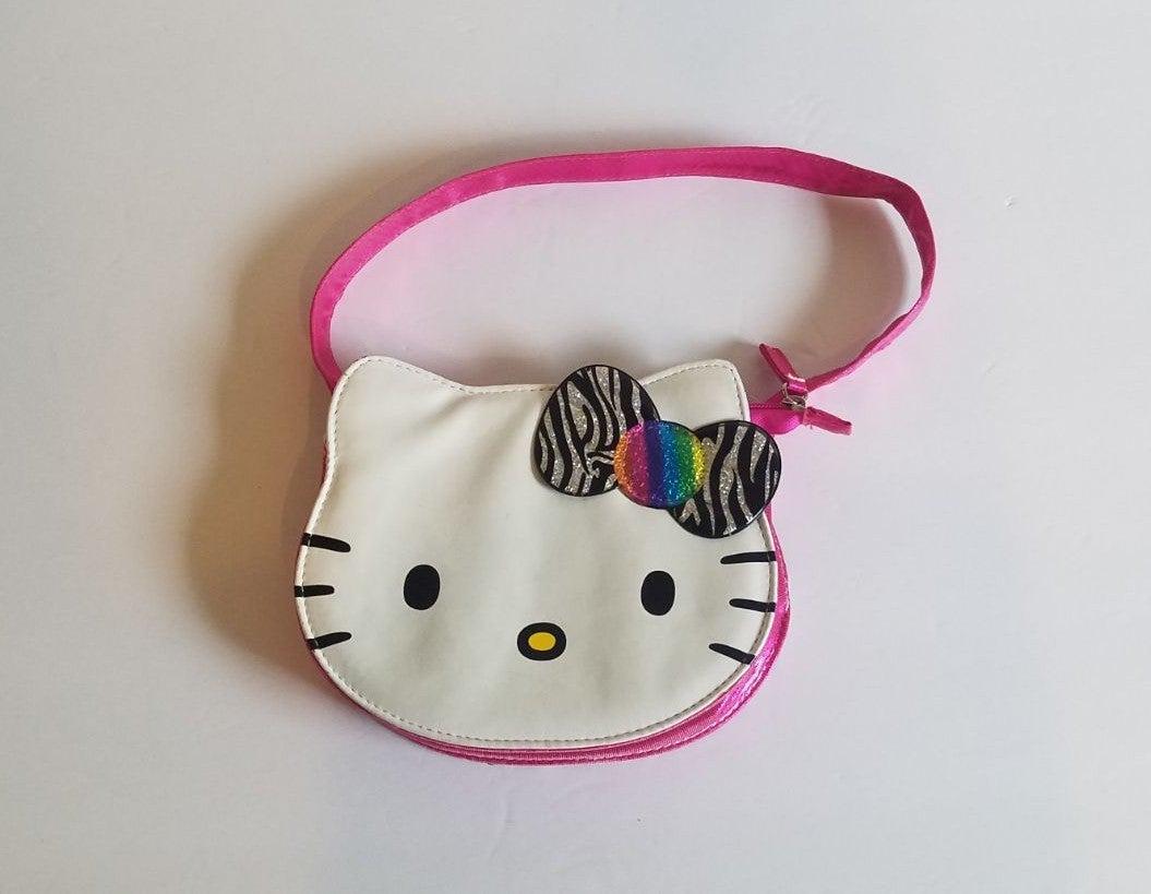 Hello Kitty purse. Rainbow bow. Leppard