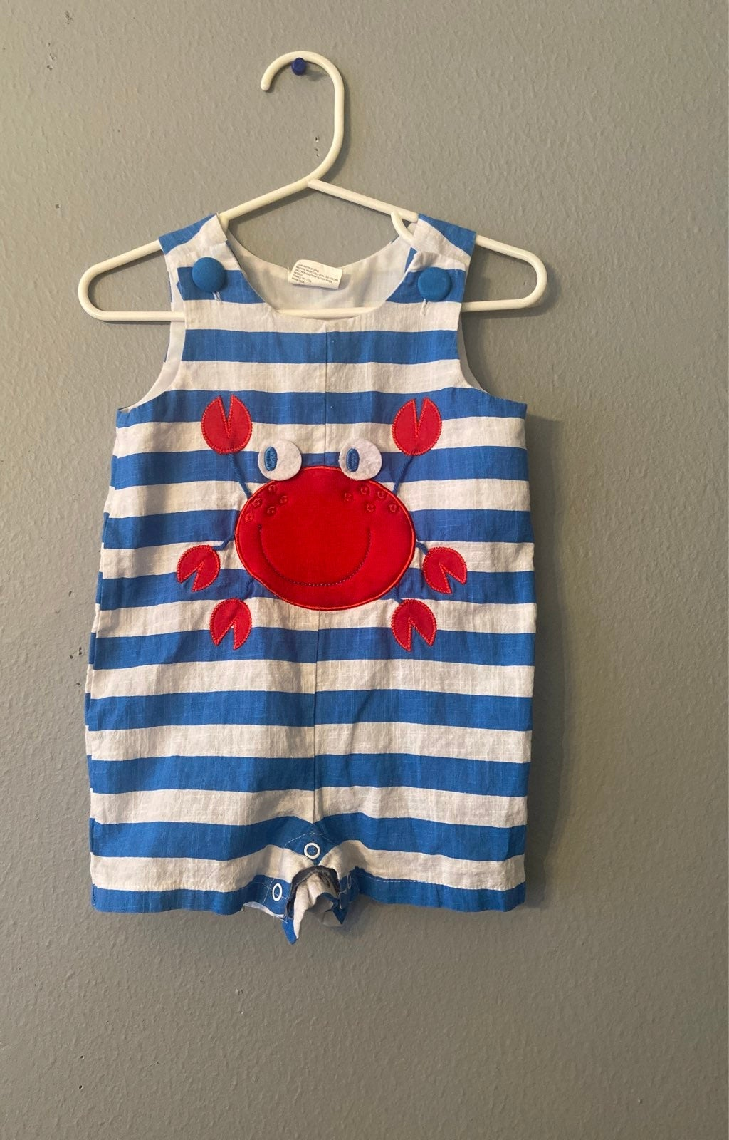 Little Wishes crab striped blue romper