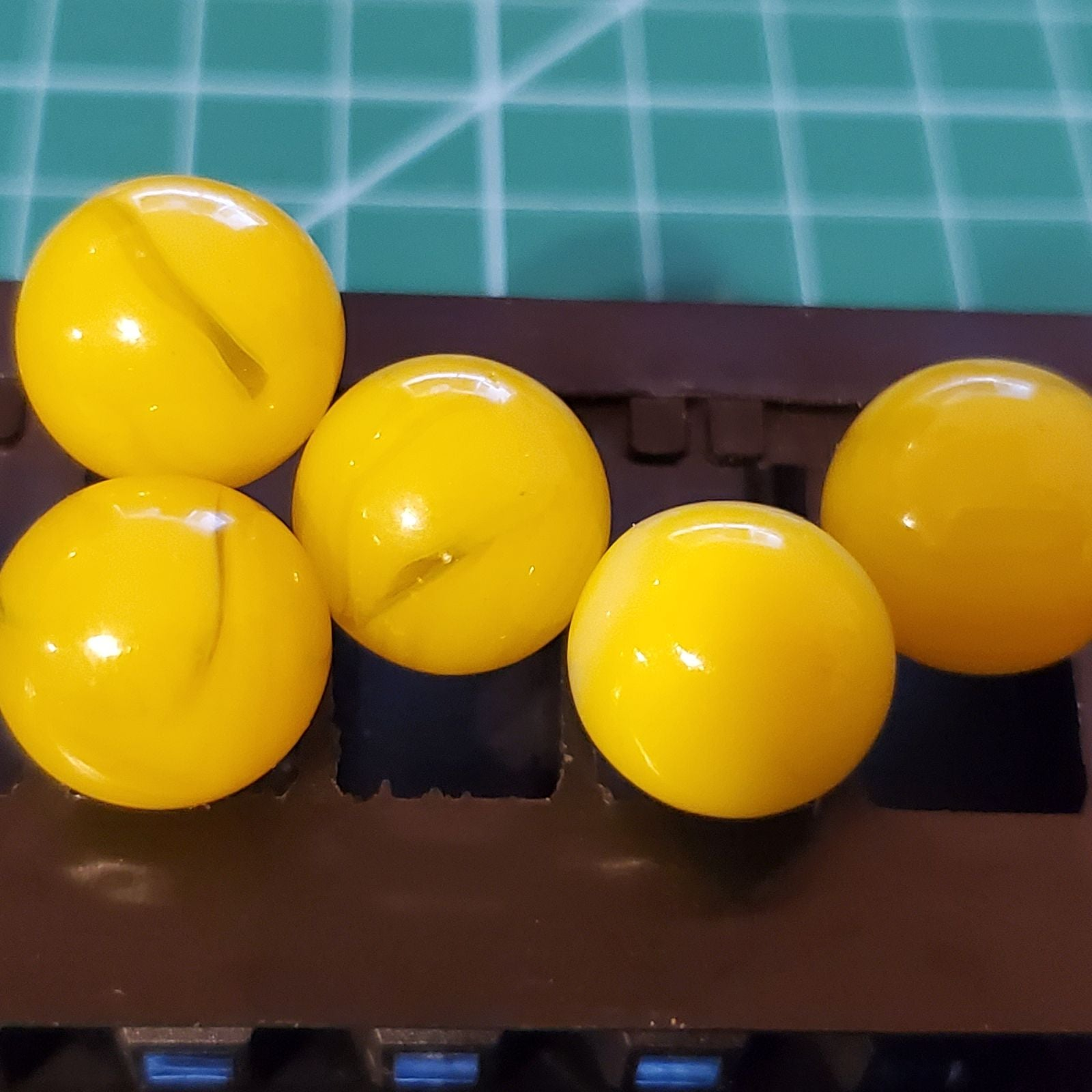 Vintage 5 yellow with swirls marbles