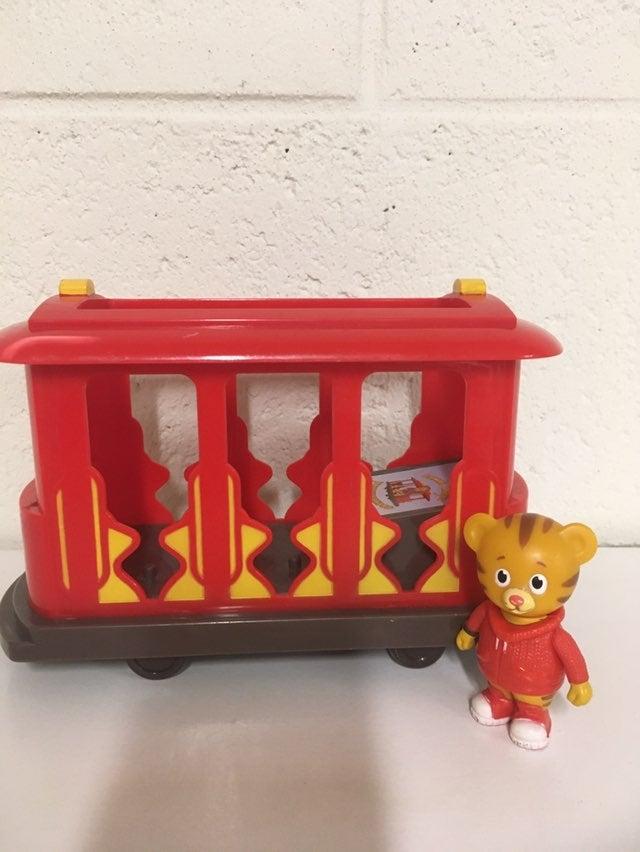 Daniel tigers pull back train