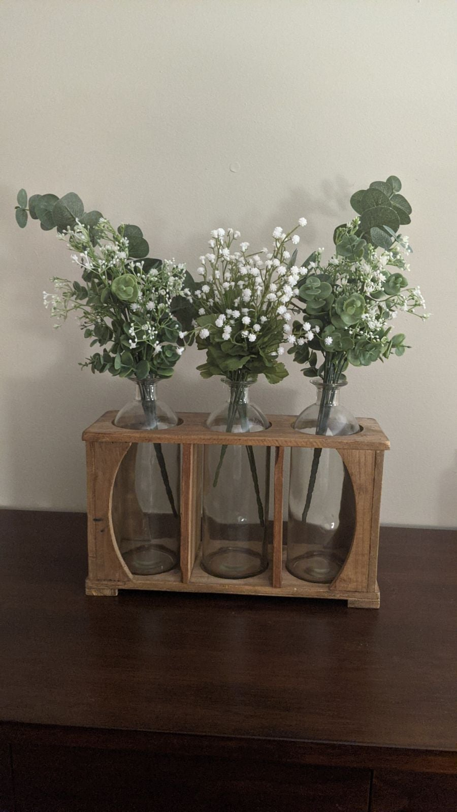 Apothecary bottle floral arrangement