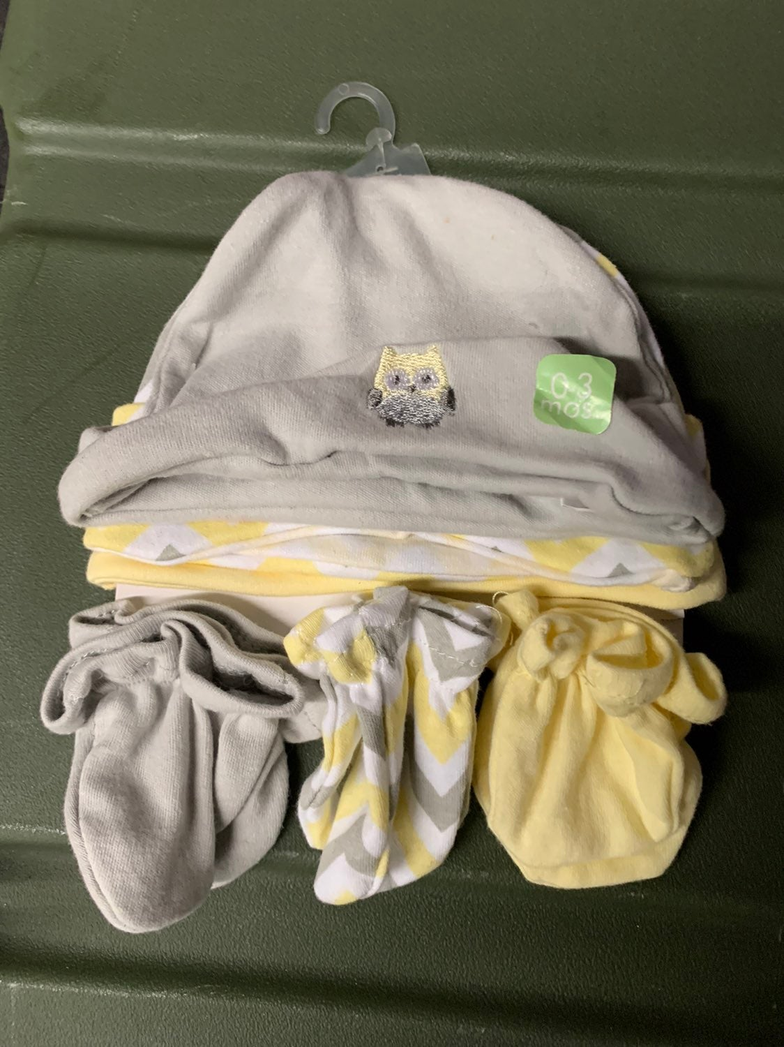 Newborn 0-3 mittens and head covers. 3 o