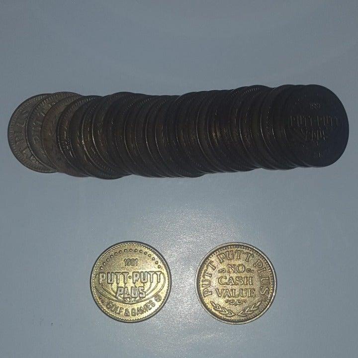 27 Putt Putt Plus Game Tokens Coins 1981