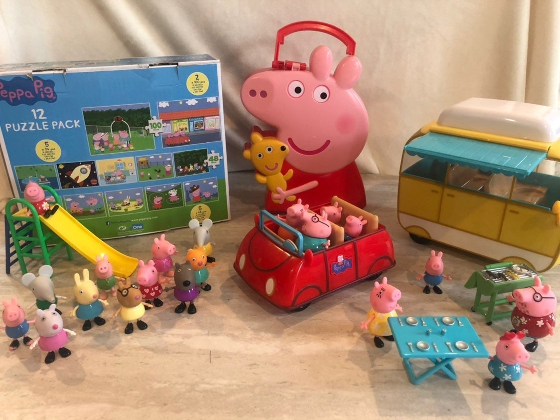 Assorted Peppa Pig toys and puzzles